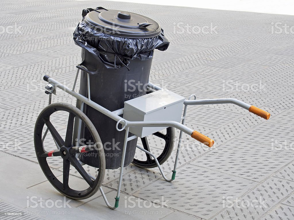 garbage bin on wheels for road paving clean royalty-free stock photo