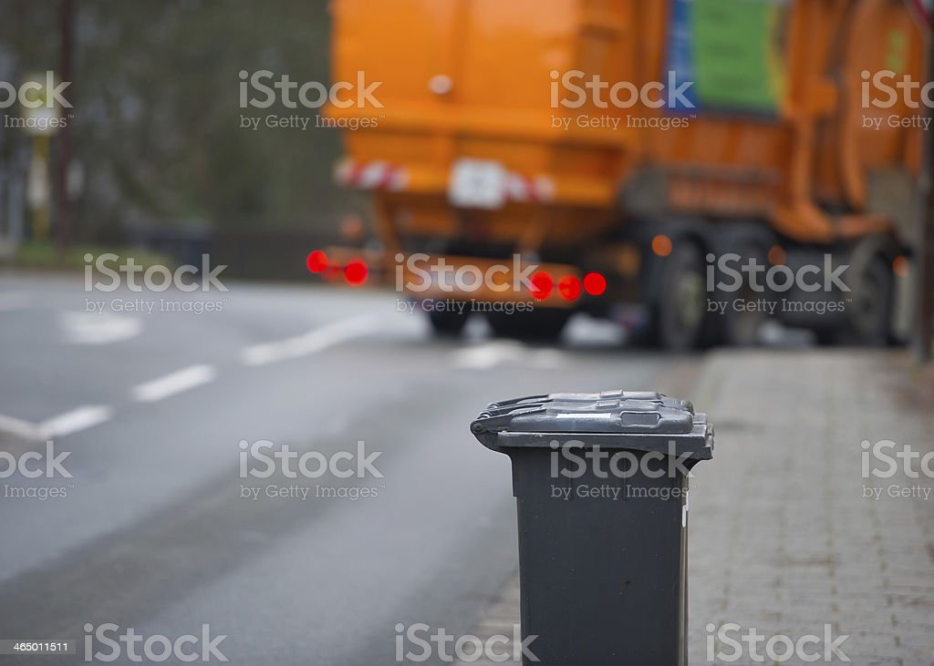 Garbage can and truck stock photo