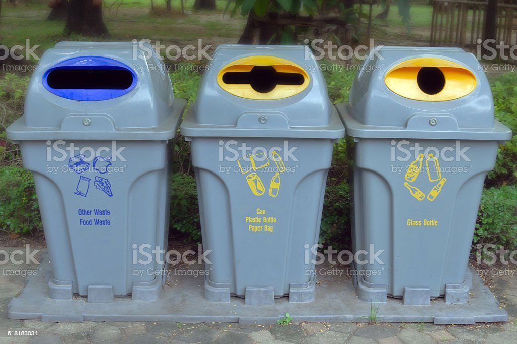 Garbage can in the garden stock photo