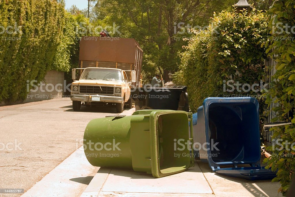 Garbage Cans and Lawn Care Two royalty-free stock photo