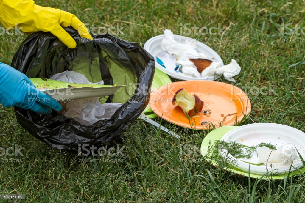 Garbage collection on the green lawn stock photo