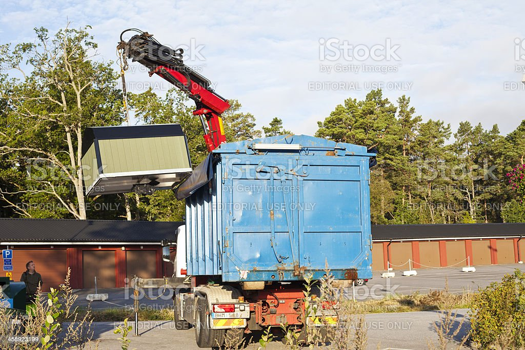 Garbage disposal with crane and lorry. stock photo