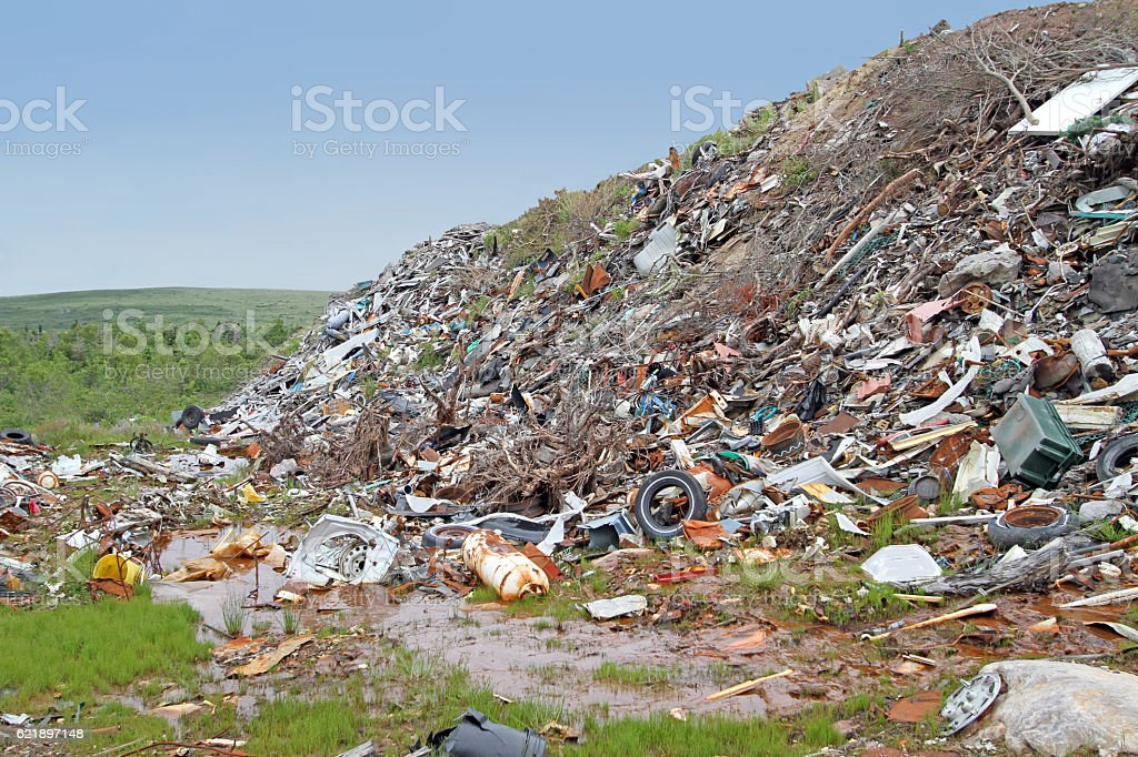 Garbage Dumped On Hillside Creating An Environmental Eyesore And Pollution stock photo