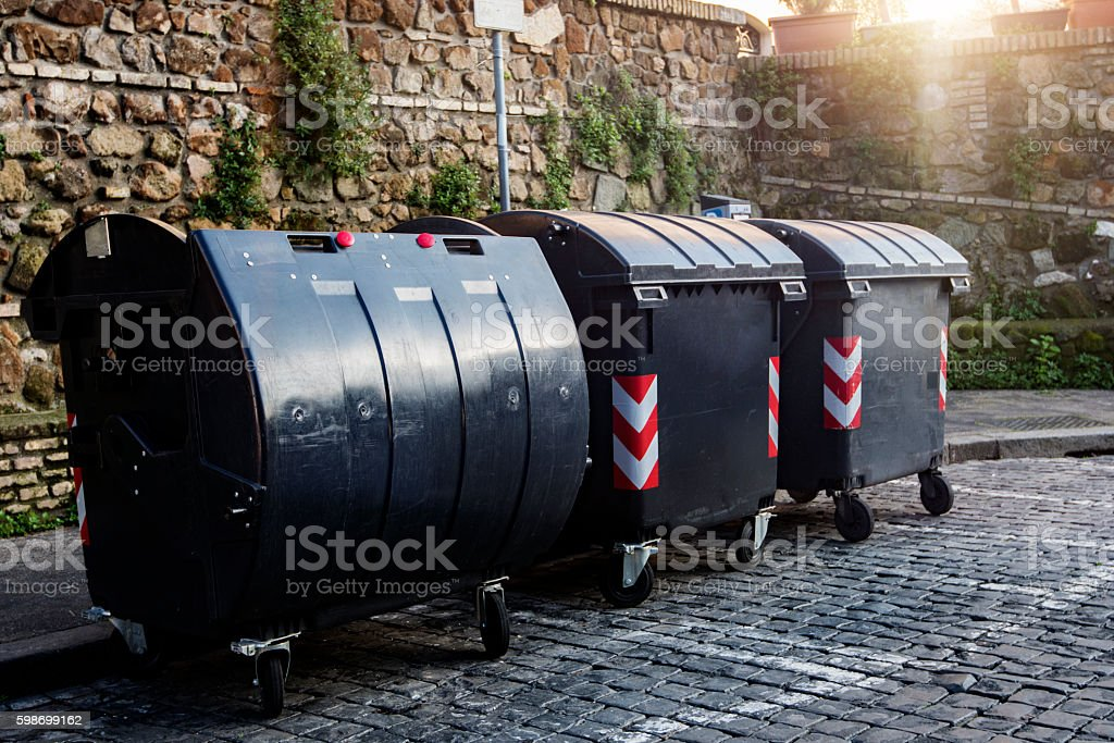 garbage dumpster in the city stock photo