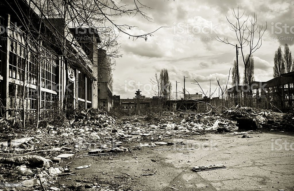 Garbage in a destroyed factory courtyard on crisis time royalty-free stock photo