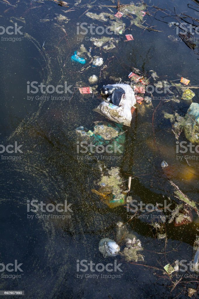 Garbage in dirty water stock photo