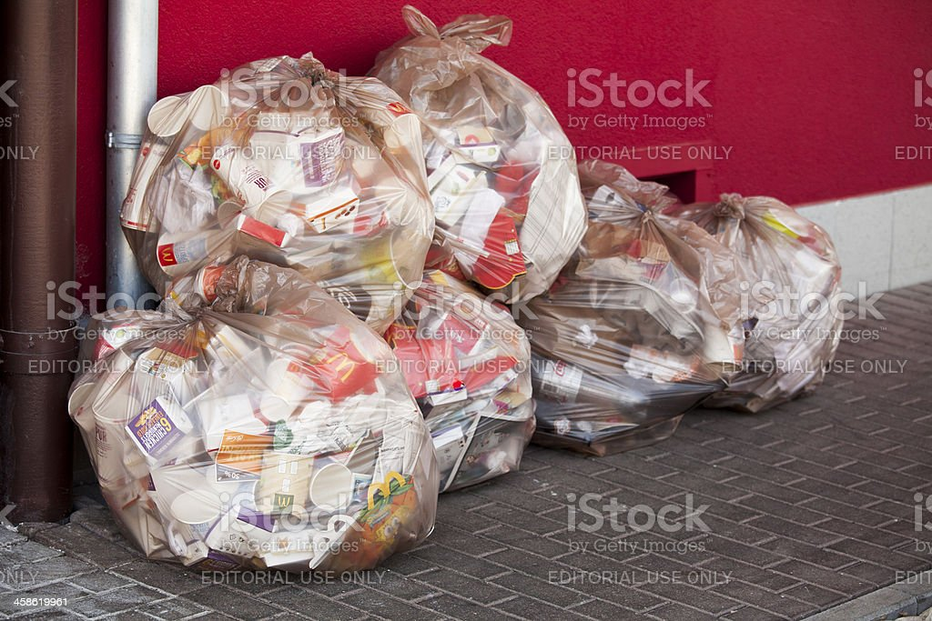 Garbage in plastic bags at a McDonald's stock photo