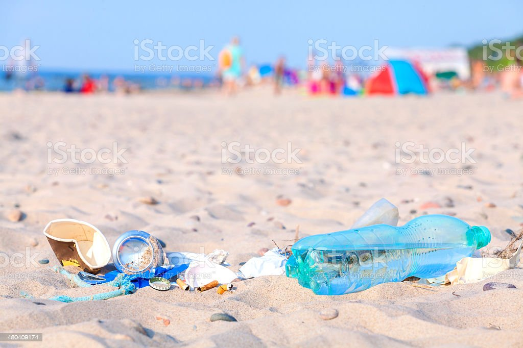 Garbage on a beach left by tourist at sunset. stock photo