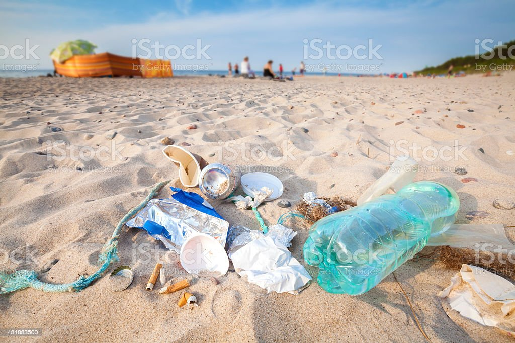 Garbage on beach left by tourist. stock photo