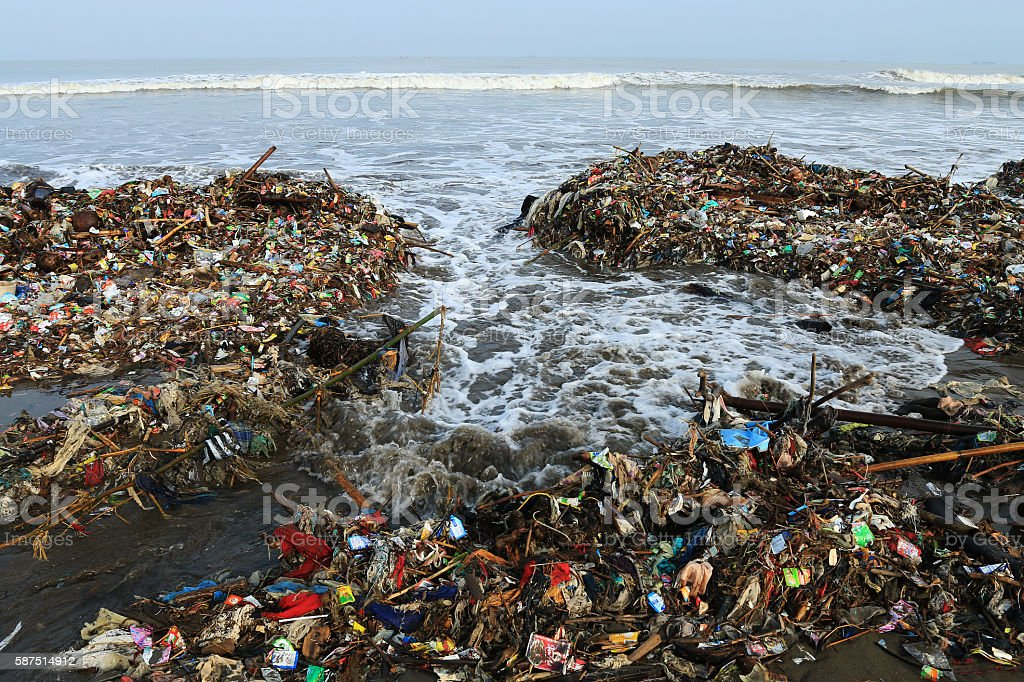 Garbage piled up on the beach. stock photo