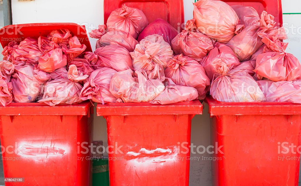 Garbage red bags stock photo