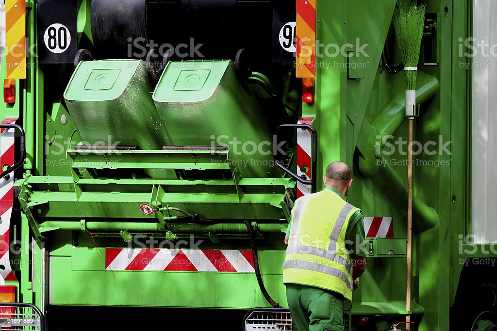 Garbage truck and worker stock photo
