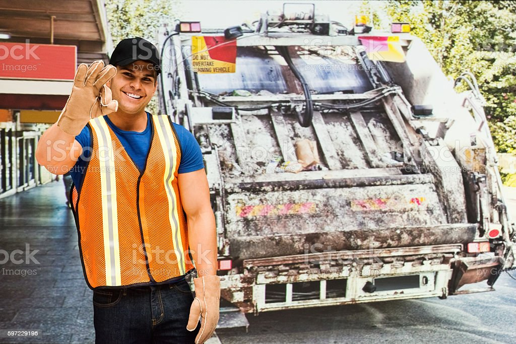 Garbage worker standing outdoors stock photo