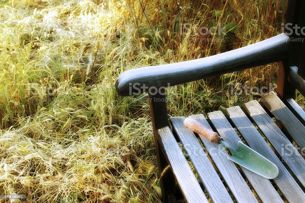 garden bench with trowel royalty-free stock photo