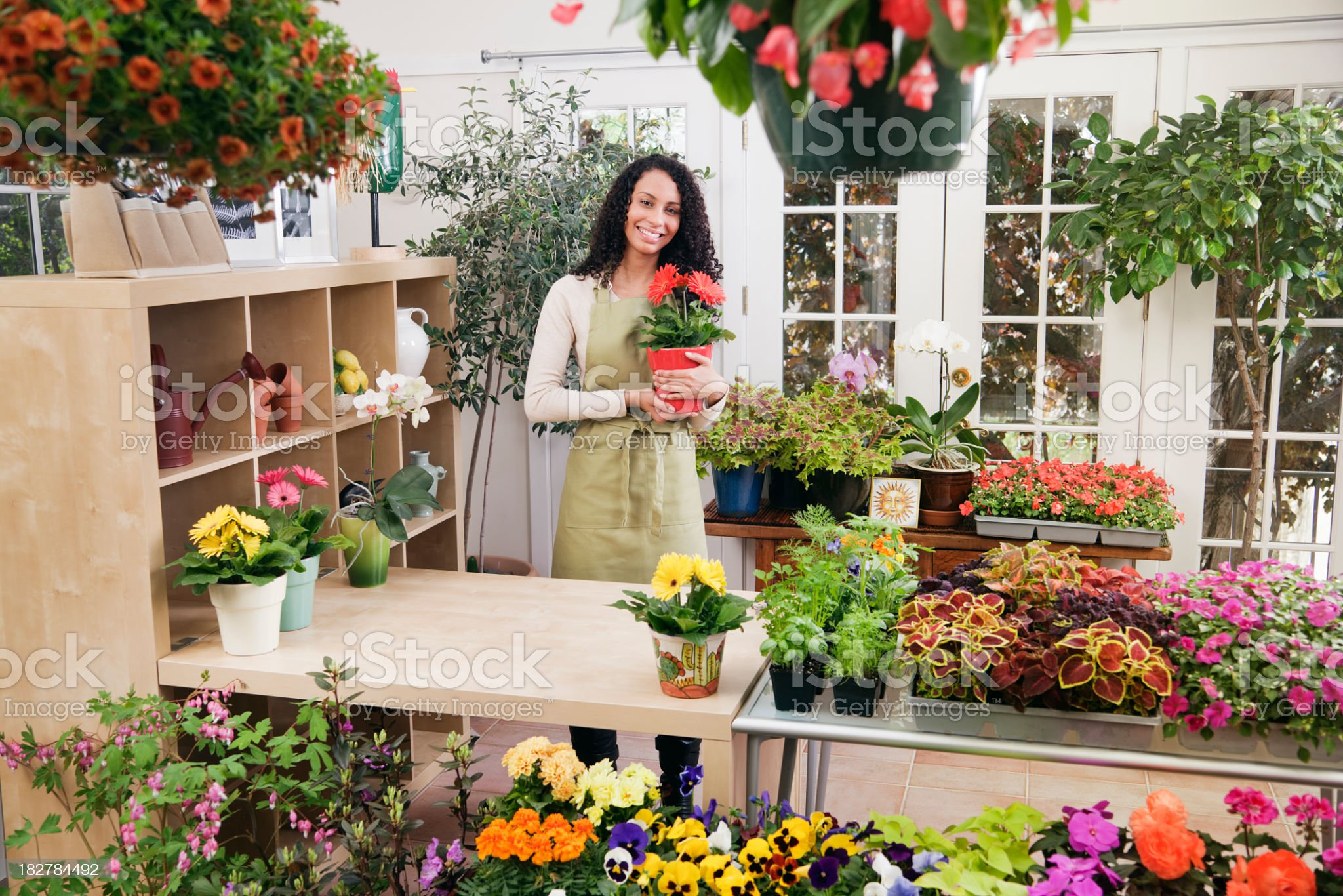 Garden Center Retail Small Business Woman Sales Person Owner Hz royalty-free stock photo