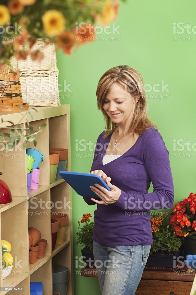 Garden Center Shop Owner Working Inventory in Store Vt royalty-free stock photo