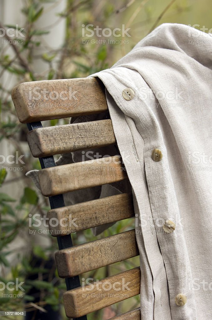 Garden chair with coat stock photo