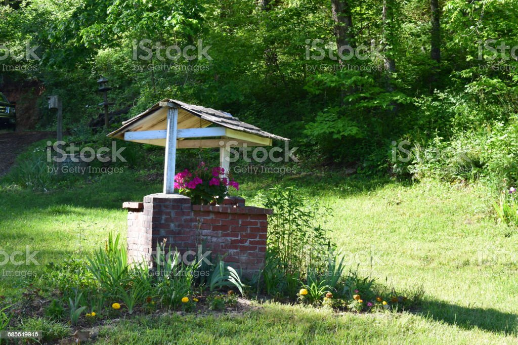 Garden country well stock photo