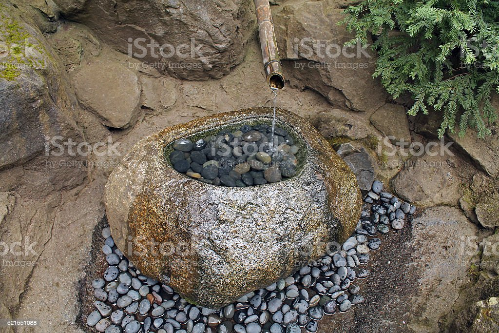 Garden Fountain made of Bamboo and Stone stock photo