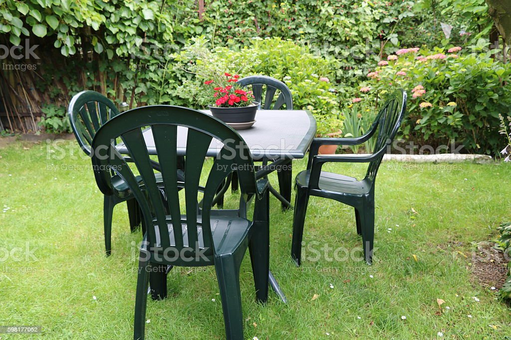 Garden furniture in the garden in summer stock photo