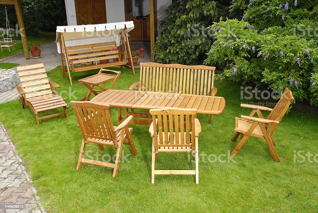 Garden furniture made of wood in lawn royalty-free stock photo