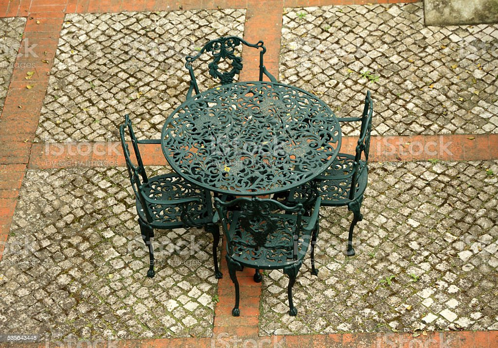 garden furniture set on paved patio stock photo