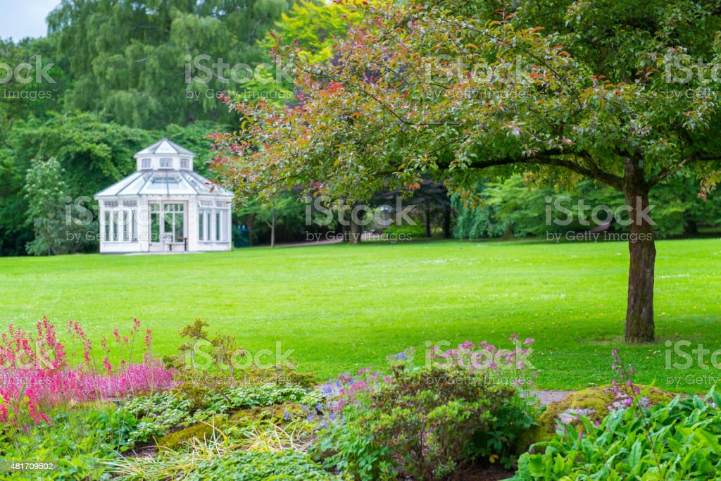 Garden Gazebo on big lawn in beautiful park stock photo