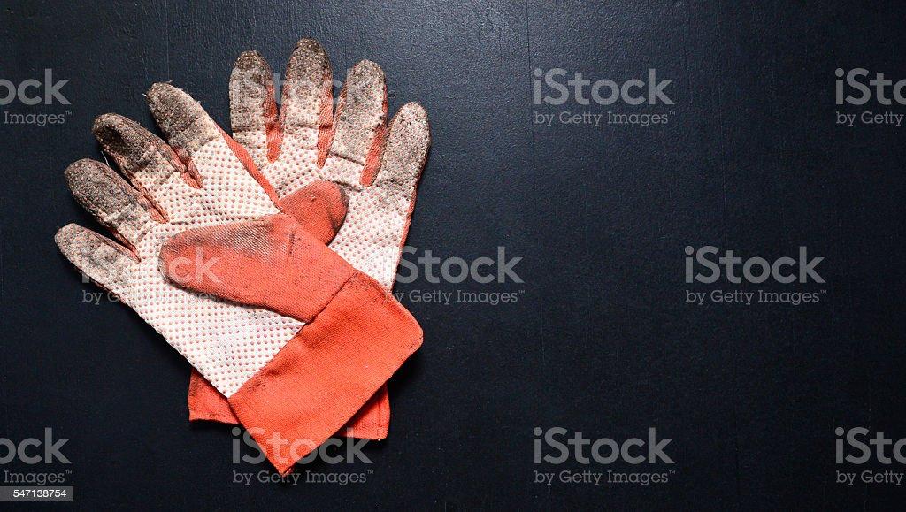 Garden gloves on blackboard stock photo