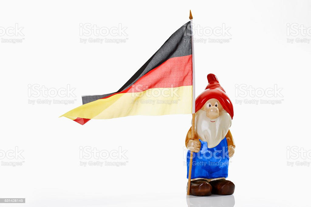 Garden gnome and german flag on white background stock photo