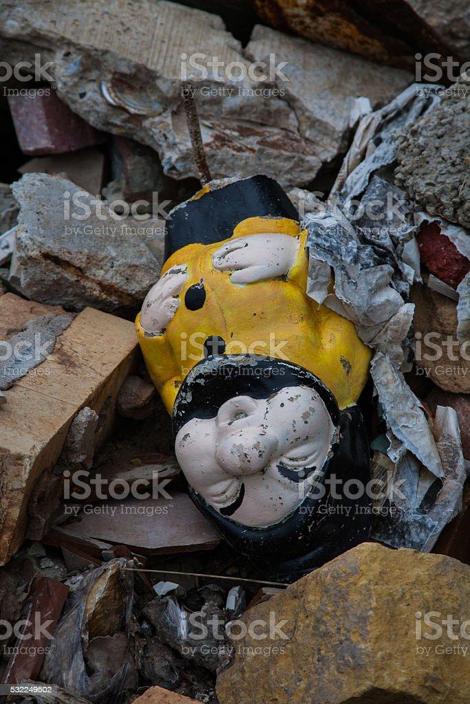 Garden Gnome in Garbage Dump stock photo
