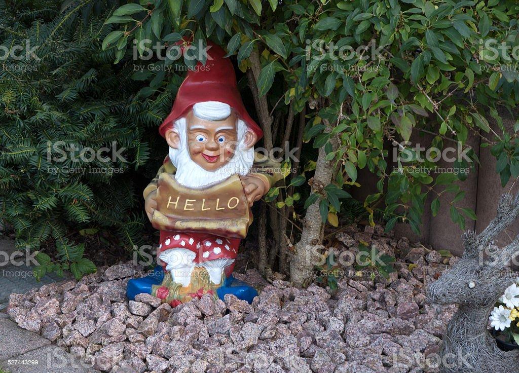 Garden gnome mit HELLO shield royalty-free stock photo