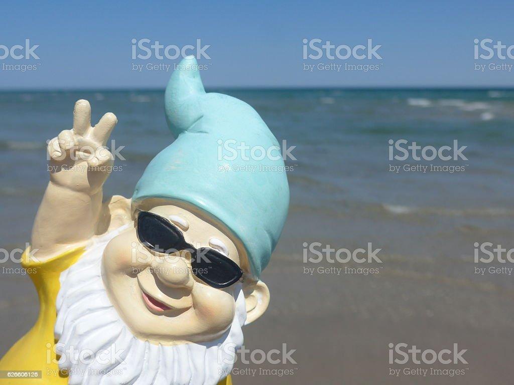 Garden gnome on vacation at sea stock photo