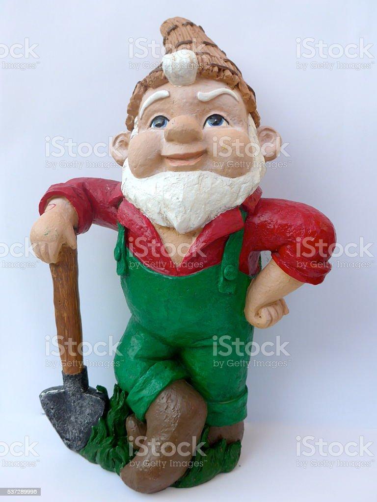 Garden Gnome with shovel stock photo