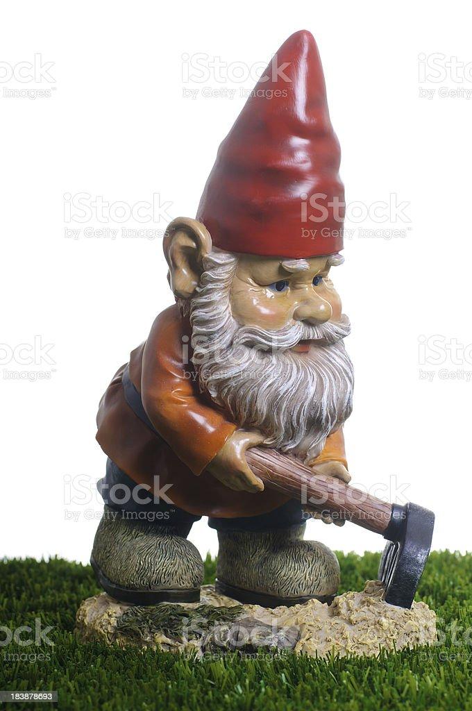 Garden Gnome working stock photo