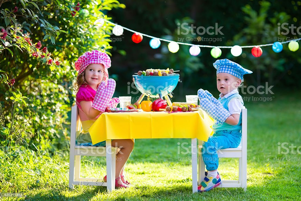 Garden grill party for kids stock photo