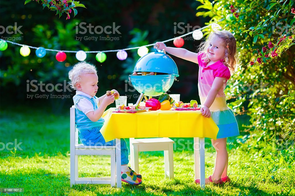 Garden grill party for little kids stock photo