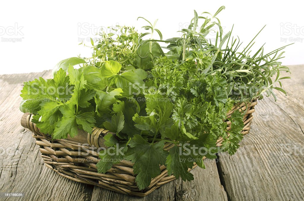 garden herbs in a wicker basket royalty-free stock photo