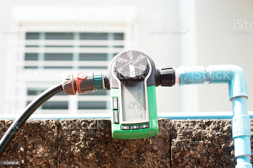 Garden House Sprinkler Timer stock photo