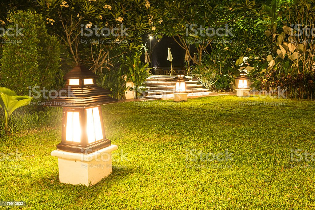 Garden lamp in garden at night stock photo