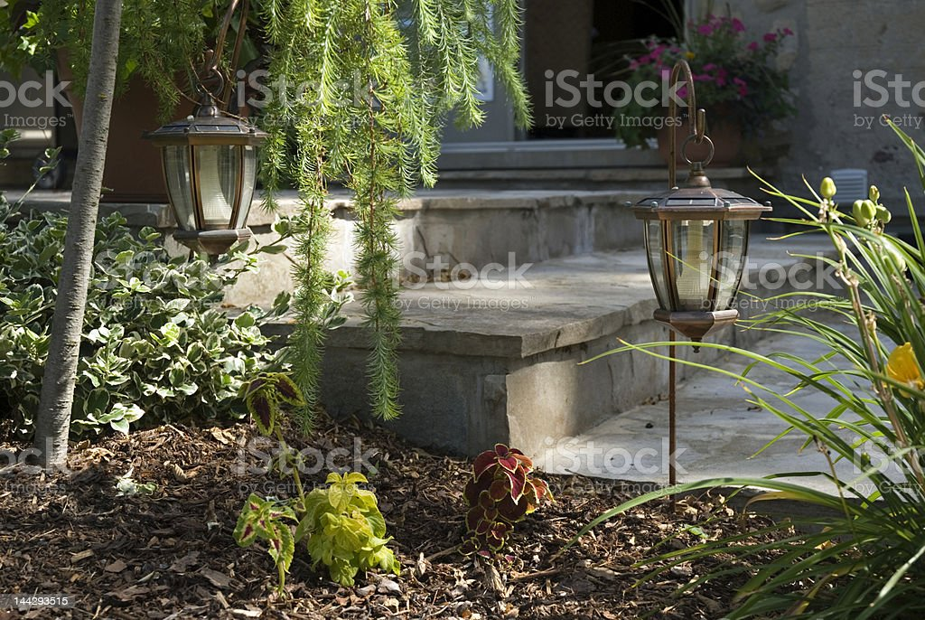 Garden lamps next to outdoor stairs royalty-free stock photo