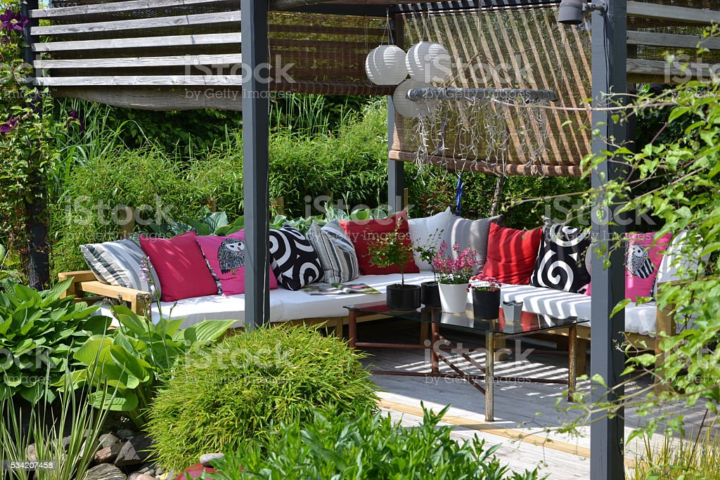 Garden Lounge with a pergola and outdoor sofa stock photo