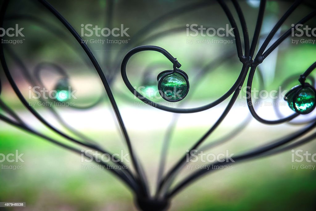 Garden Ornament Green Glass And Wrought Iron stock photo