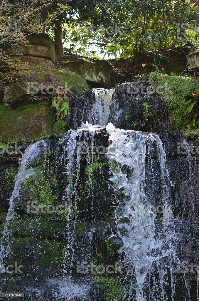 Garden ornamental waterfall. stock photo