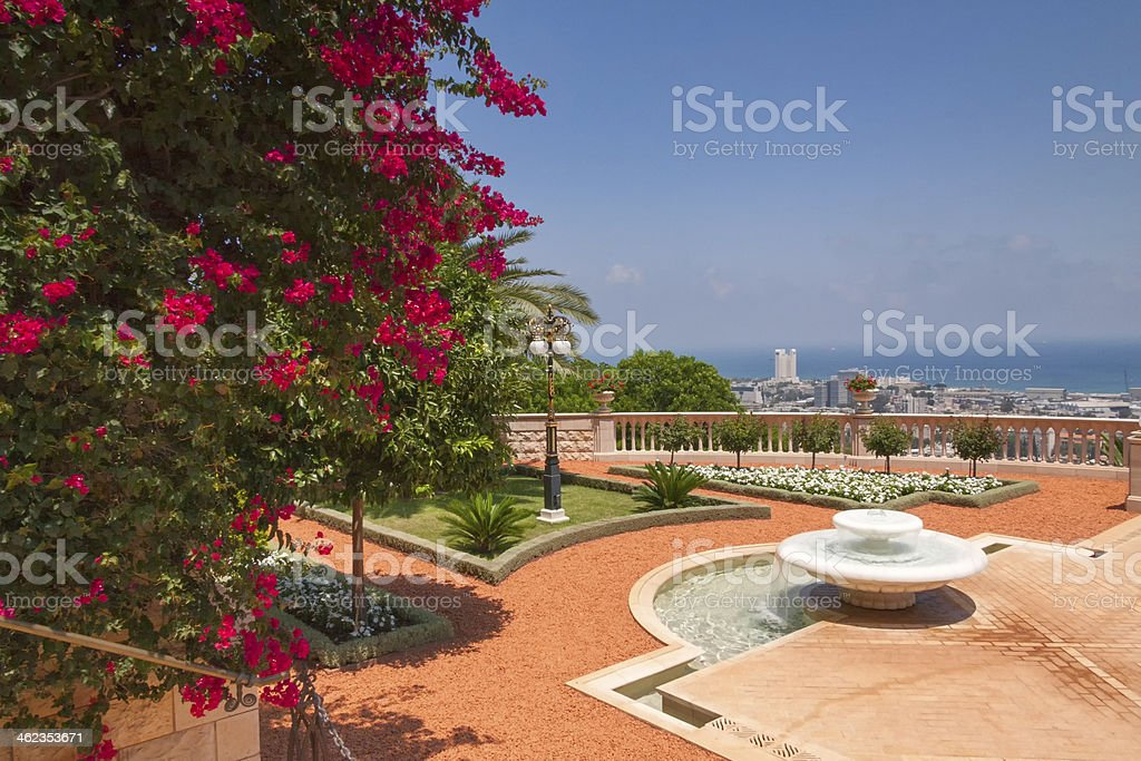 Garden park with paths, fountain and blossoming flowers in flowerbeds stock photo