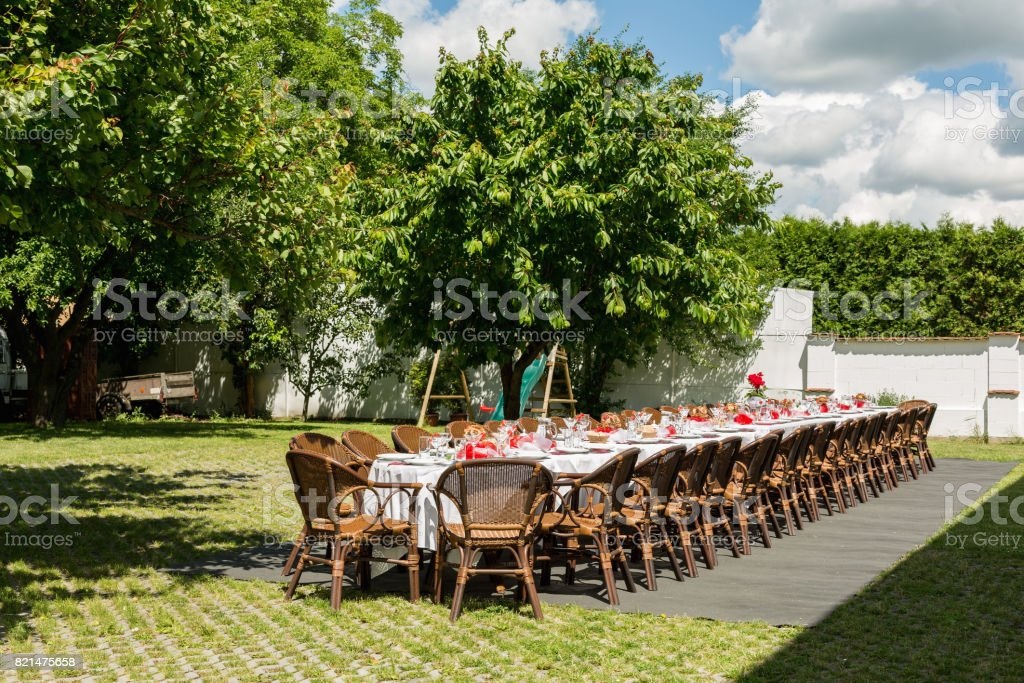 garden party set up for lunch dinner with long table , Decorated...