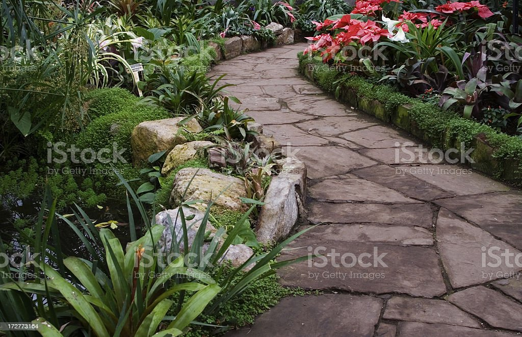 Garden path and flower beds stock photo