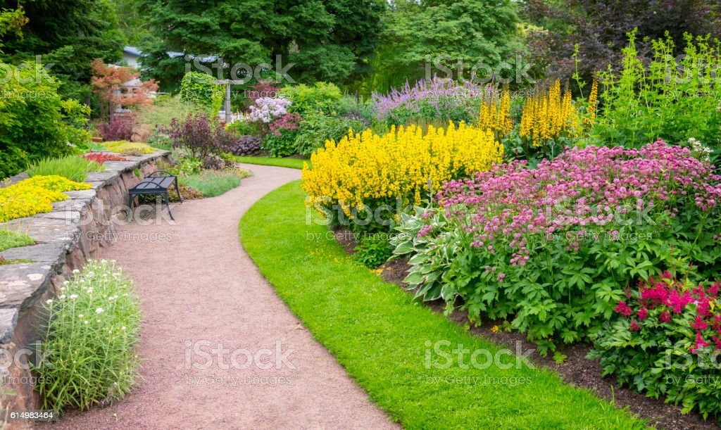 Garden path and flowerbeds in beautiful park stock photo
