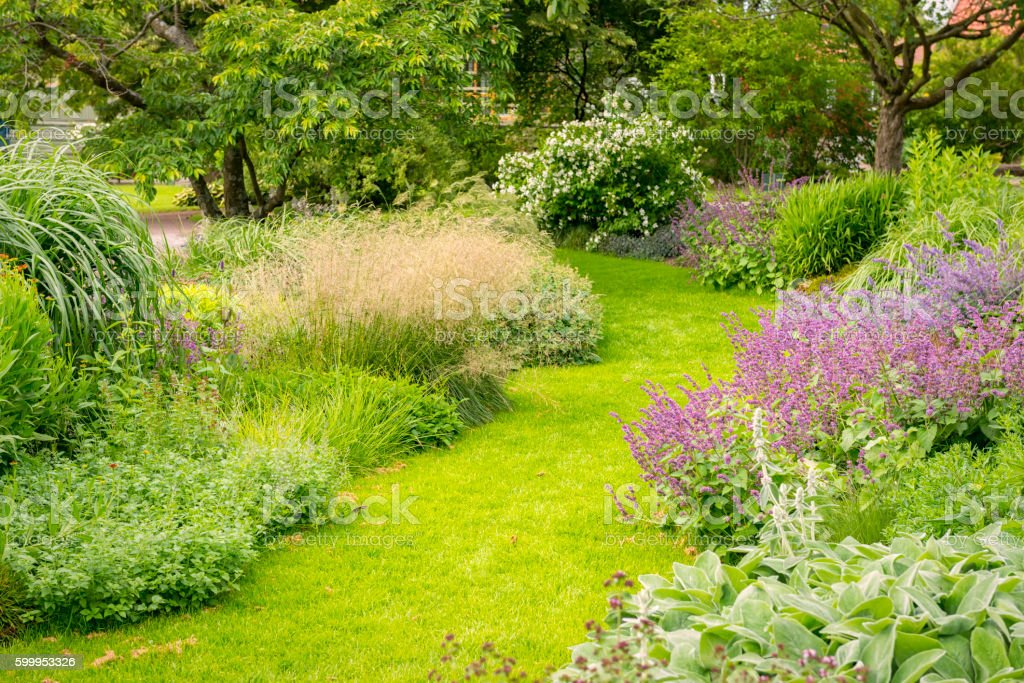 Garden path and flowerbeds stock photo