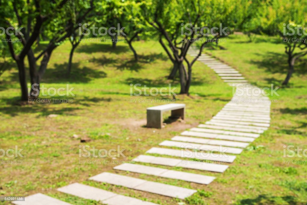 Garden path defocused abstract background stock photo