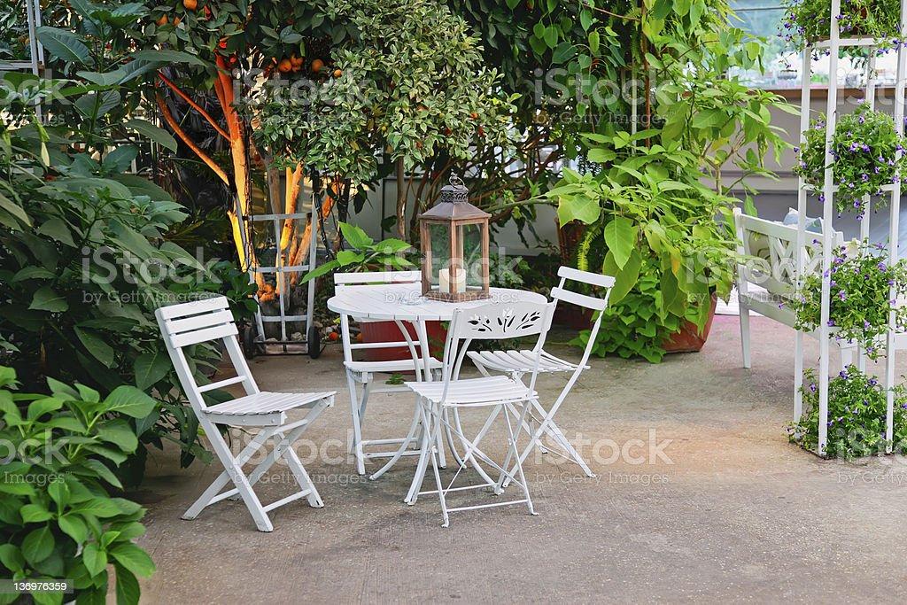 Garden patio with white furniture royalty-free stock photo